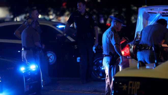 TPD and FHP inspect the car of Carrie Ann Keeton, 29, who was arrested after troopers spun her Chevy car into the median on North Magnolia Drive Tuesday evening.