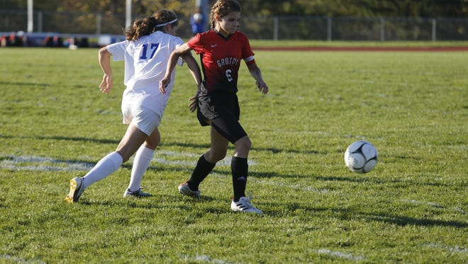 Groton's Lilly McCormick, right, fights off Lansing's Rowan Lawrence during Friday's game.