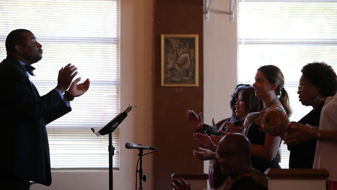 Andrew Dixon leads the choir during at St. Eugene Catholic Mission and Student Center during its 65th anniversary in 2017. This November, the church is celebrating African American Catholic History Month.