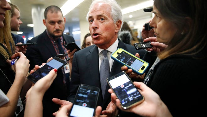 Sen. Bob Corker, R-Tenn., speaks to reporters while heading to vote on budget amendments on Oct. 19, 2017.