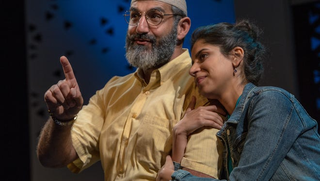 """Brian Abraham and Nikita Tewani share a moment in Milwaukee Repertory Theater's production of """"The Who & the What."""""""