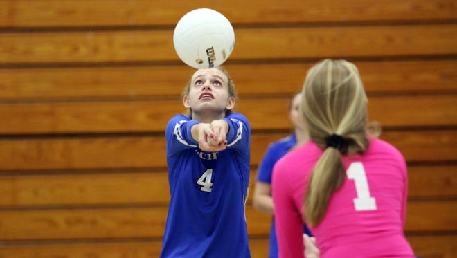 Barron Collier's Anna Marie Parisi bumps the ball during the Class 7A regional quarterfinal between the Cougars and Estero at Barron Collier High School on Wednesday, Oct. 25, 2017.