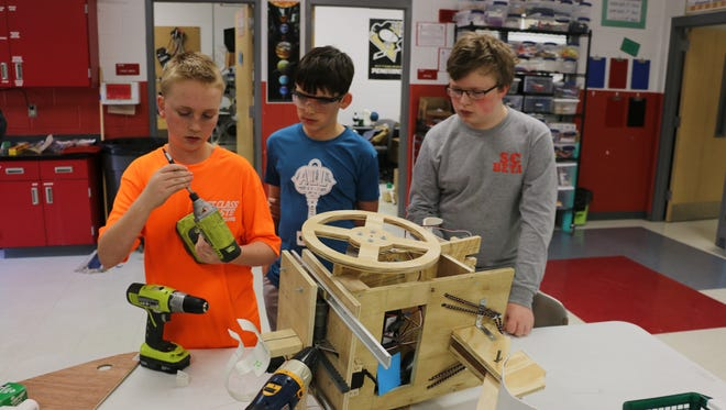 Stewarts Creek Middle robotics team members Zander Castleman, Reese Pittman and Jackson Campbell, from left, work on their robot for Saturday's B.E.S.T. Robotics competition at Lipscomb University.