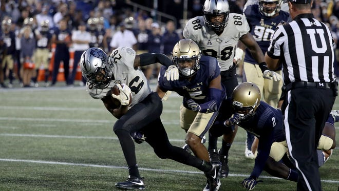 UCF wide receiver Otis Anderson rushes for a fourth quarter touchdown against Navy last weekend.