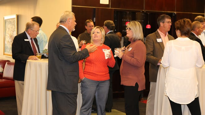 Brian Taylor, CDE Lightband General Manager, greets guests at a reception to celebrate CDE Lightband's service milestones of 20,000 broadband and 70,000 electric customers.