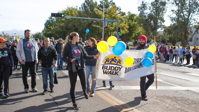 The National Down Syndrome Society Buddy Walk make their way down the parage route at the NMSU Homecoming Parade on October 28, 2017.