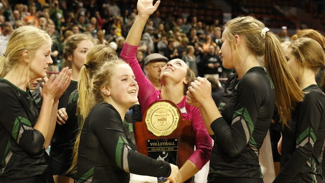 Fossil Ridge, shown here with last year's state championship trophy,  along with Rocky Mountain, Fort Collins, Windsor and Resurrection Christian will all serve as host volleyball regional sites Saturday.