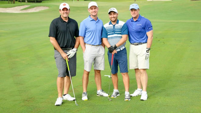 From left are Charles Bender, Jason Brian, Daniel DiDonna, Mark Montgomery.