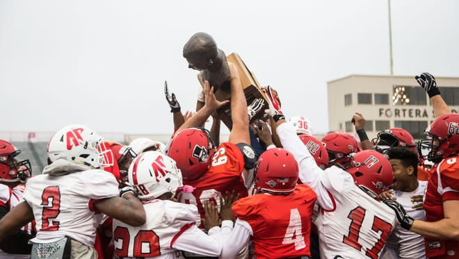 Austin Peay hoists the Sgt. York Trophy before practice on Tuesday, November 7, 2017.
