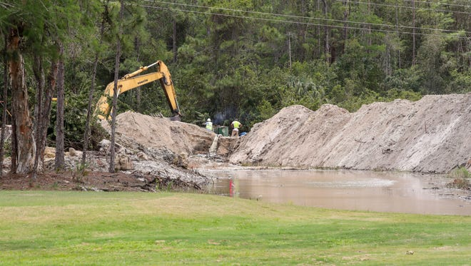 Construction crews work on drainage problems on the front end of Eastwood Golf Course on May 19, 2017, as a road goes in. Fort Myers will take out a $2 million loan to repair the front nine holes as the city builds the Hanson Street extension through the middle of the course.