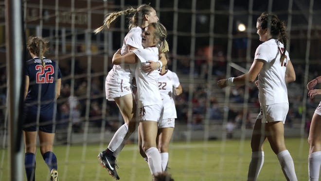 FSU's Gabby Carle, left, celebrates with Taylor Hallmon after scoring a goal during FSU's 5-0 NCAA tournament win at the Seminole Soccer Complex last week.