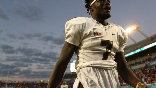 FAMU's Brandon Norwood tears up as he walks off the field against Bethune-Cookman after the Rattlers 29-24 Florida Classic loss at Camping World Stadium in Orlando Saturday, Nov. 18, 2017.