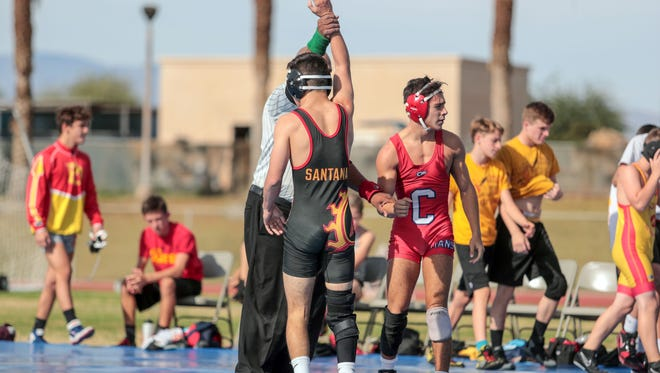 Wrestles from Cathedral City High, Palm Desert High, Bonita High and Colony High compete in an outdoor match at Cathedral City High on Tuesday, November 21, 2017.