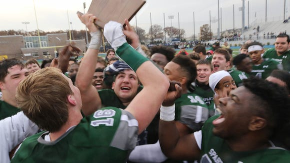 DePaul fullback Vinny DePalma looks up at this team's trophy at the end of the game.