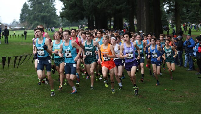 Boys runners compete in the Nike Cross Nationals on Saturday at Glendoveer Golf Course in Portland, Oregon.