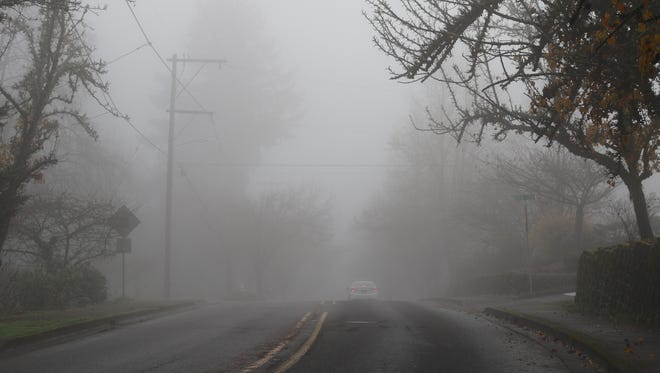 Heavy fog socks in Salem Monday, December 4, 2017.
