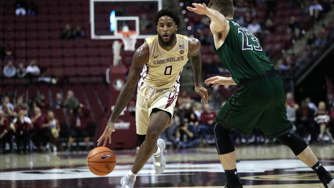 FSU's Phil Cofer drives past Loyola of Maryland's Brent Holcombe during their game at the Tucker Civic Center on Wednesday, Dec. 6, 2017.