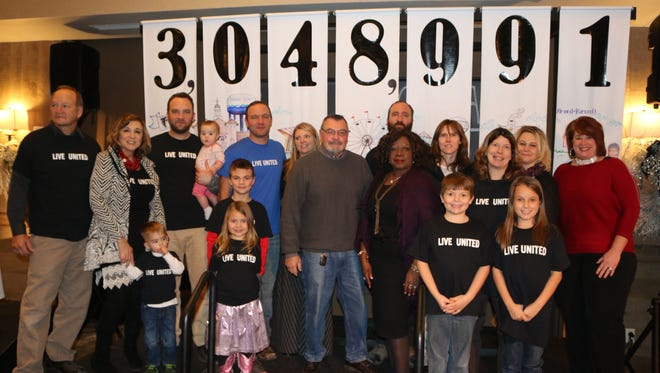 Members of the Blenker family, United Way of Portage County 2017 Campaign Drive Chairs, along with United Way supporters throughout all of Portage County, reveal the 2017 United Way of Portage County campaign total – a record-breaking $3,048,991 – at this year's Victory Celebration at SentryWorld in Stevens Point.
