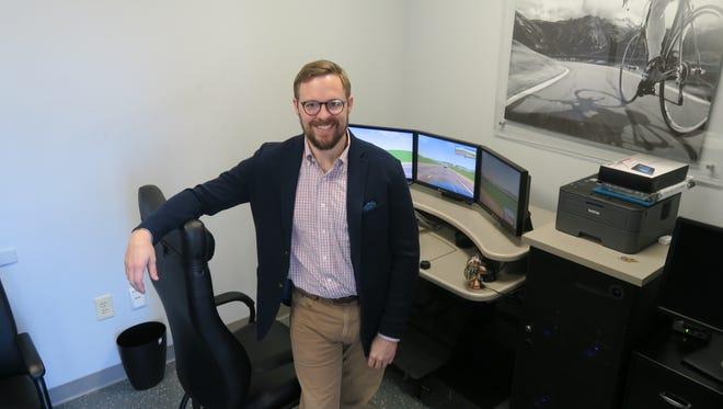 Dr. John Lucas, head of Spartanburg Regional's Sports Medicine Institute, with the driving simulator