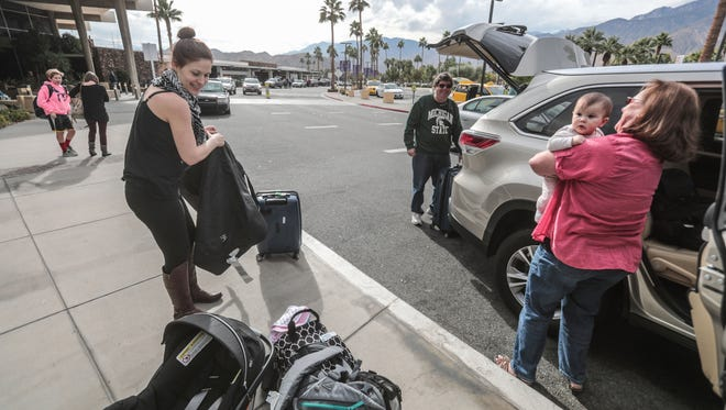 Mike and Dona Lally, of Rancho Mirage, pick up their daughter-in-law Meghan and 7-month-old granddaughter, Sophia, at Palm Springs International Airport on Saturday, December 16, 2017.
