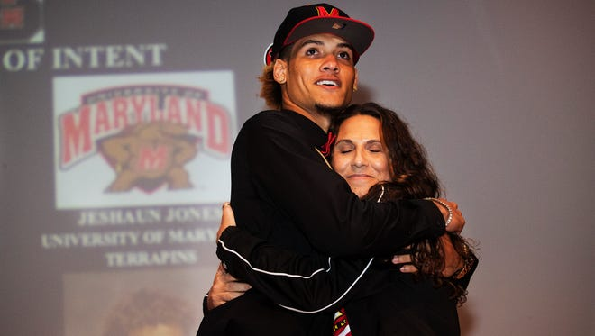 South Fort Myers football player Jeshaun Jones hugs his mother, Nicole Baran after signing with Maryland on Wednesday.