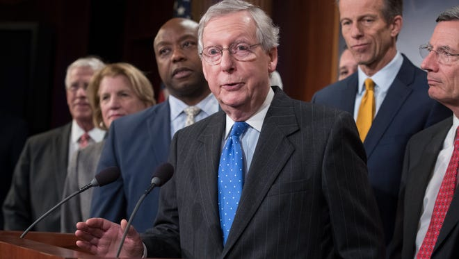 Senate Majority Leader Republican Mitch McConnell (C) is pictured speaking beside other Senate Republicans during a news conference after the Senate passed the Republican tax plan early Wednesday.