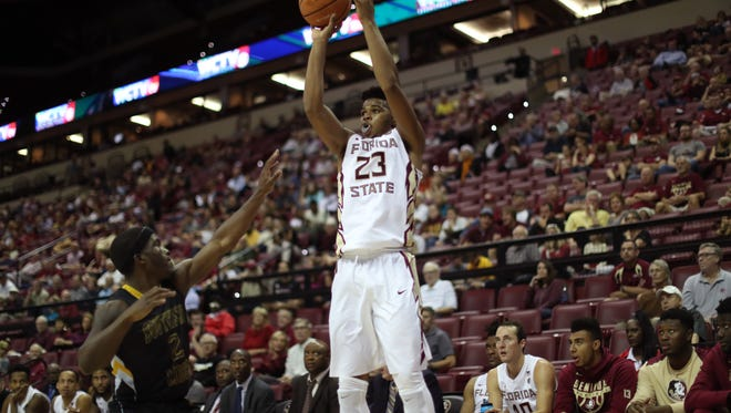 FSU's M.J. Walker makes a 3-pointer over Southern Miss' D'Angelo Richardson during their game at the Tucker Civic Center on Thursday, Dec. 21, 2017.