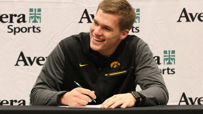 Seth Benson of Washington High is all smiles after signing to play at Iowa on Friday at the Avera Sports Institute in Sioux Falls.
