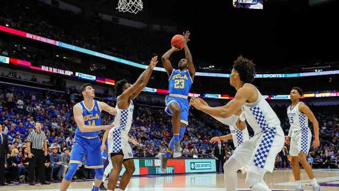 Dec 23, 2017; New Orleans, LA, USA; UCLA Bruins guard Prince Ali (23) shoots a jump shot during the first half against Kentucky Wildcats at Smoothie King Center. Mandatory Credit: Stephen Lew-USA TODAY Sports