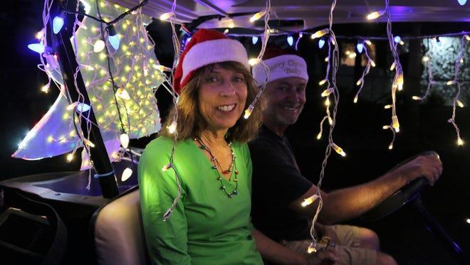 Longtime Capri resident Diane Eiler is all smiles. On Christmas Eve, Dec. 24, 2017, Capri residents gathered for the 10th Annual Golf Cart Parade.