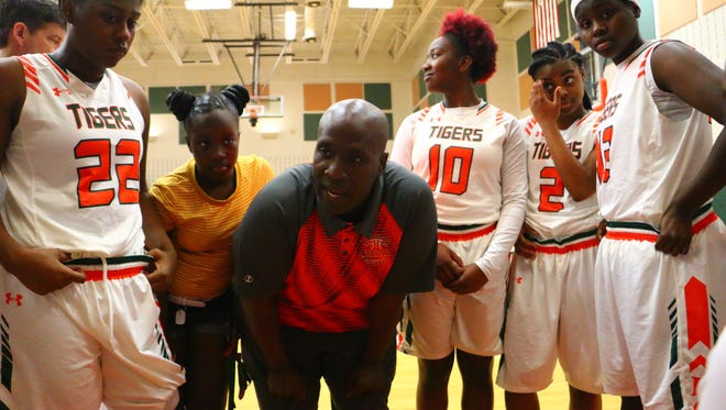 Dunbar coach Dwayne Donnell chats with his team during a timeout at the Queen of Palms tournament on Thursday.