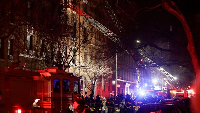 Firefighters respond to a building fire Thursday, Dec. 28, 2017, in the Bronx borough of New York. The Fire Department of New York says a blaze raging in the Bronx apartment building has killed at least six and seriously injured more than a dozen.