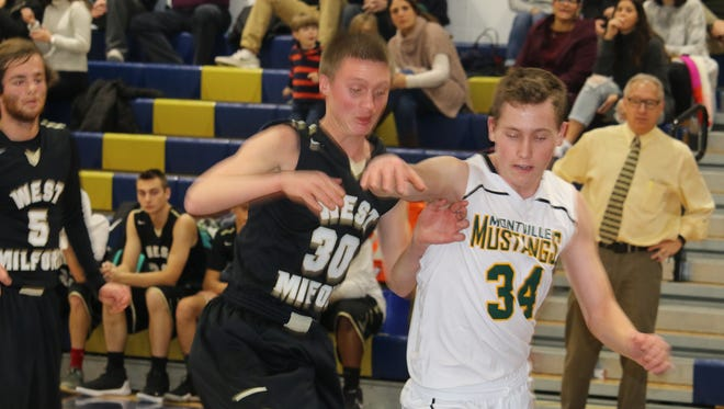 Josiah Basket (30) and the West Milford boys' basketball team dropped a 76-57 contest to Montville on Thursday night in the championship game of the annual Pequannock Blue & Gold Holiday Tournament in Pompton Plains.