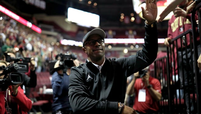 FSU's new Head Football Coach Willie Taggart high-fives fans during halftime of the Seminoles game against Loyola of Maryland at the Tucker Civic Center on Wednesday, Dec. 6, 2017.