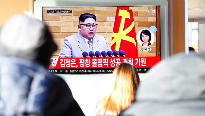 South Korean people watch a TV news broadcast reporting on North Korean leader Kim Jong-Un's New Year's address, at a station in Seoul, South Korea, 01 January 2018. In a televised New Year's speech, the North Korean leader commented on the North's nuclear progress, media reported.