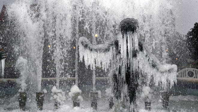 The fountain on Landis Green on Florida State University's campus as mix of freezing rain, sleet and light snow hits Tallahassee on Wednesday, January 3, 2018.