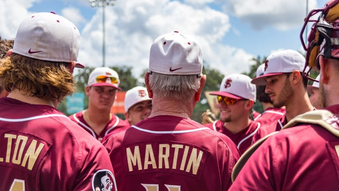 Legendary coach on Mike Miller gives his team a peptalk before the Noles comeback win over Sam Houston state University by a score of 7-6 on Sat. Jun, 12 at Dick Howser Stadium .