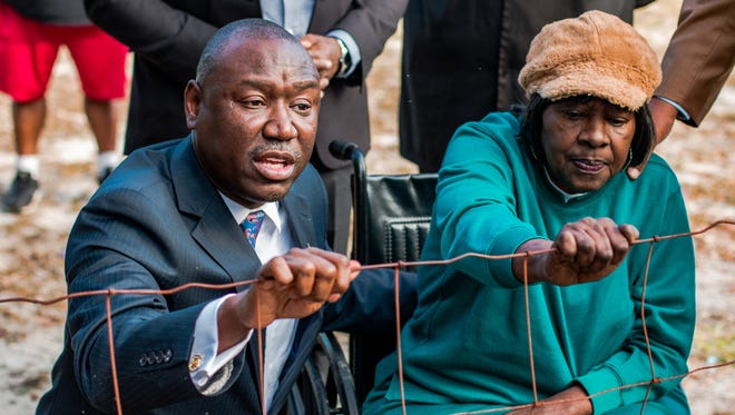 Ben Crump and Gwen Lillian Thomas,  a 70-year-old African-American activist from Camilla, are seen during a press conference on Dec. 22 at Camilla's Oakview Cemetery in which Crump called on the city to remove the fence segregating blacks from whites in the city-owned cemetery.