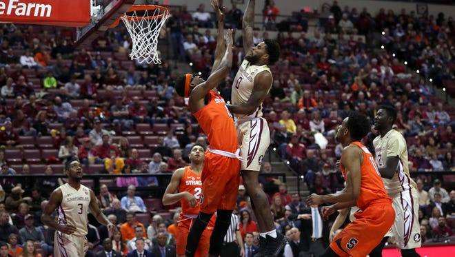 FSU's Phil Cofer goes up for a dunk against Syracuse's PaschalChukwu during their game at the Tucker Civic Center on Saturday, Jan. 13, 2018.