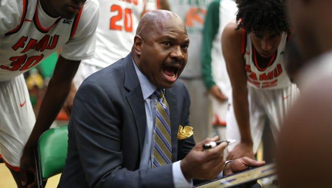 FAMU basketball head coach Robert McCullum talks to his team during a timeout.