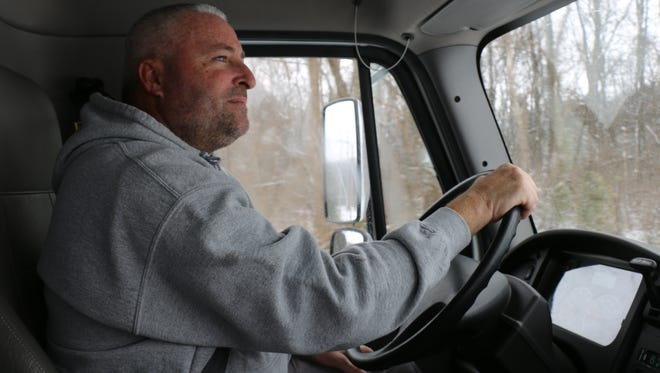 Brian Goins drives the City of Franklin Street Department salt truck on Edward Curd Lane on Tuesday, Jan. 16, 2018.