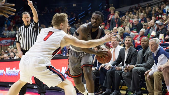 Austin Peay guard Tre' Ivory looks to pass against OVC rival Belmont.