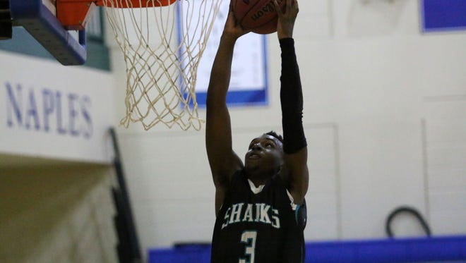Cardin Joubert grabs a dunk off the breakaway during the Sharks' win over Community School on Tuesday.