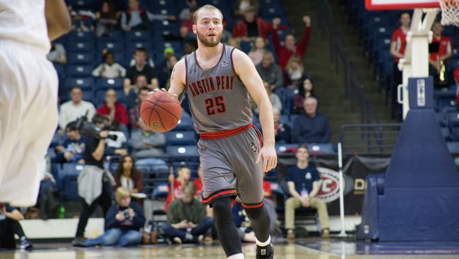 Austin Peay guard Zach Glotta dribbles the ball up the court against Belmont on Jan. 20.