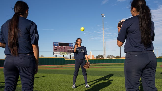 Carroll softball players warm up during practice at Cabaniss Softball Field on Wednesday, Jan. 24, 2018.