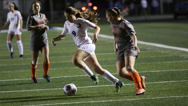 Barron Collier senior Alyssa Pilavis dribbles up the field during the first half of the Class 3A-District 14 championship game between the Cougars and Lely on Friday.