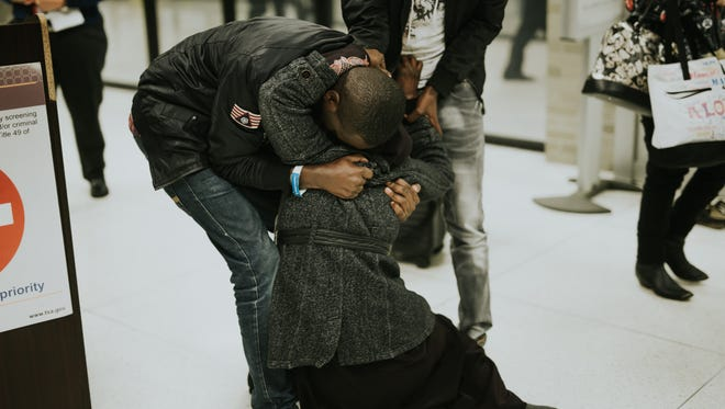 Shukriya, a refugee from Ethiopia, falls into the arms of her sons, both newly arrived refugees, at Memphis International Airport in October. They hadn't seen each other in 10 years.