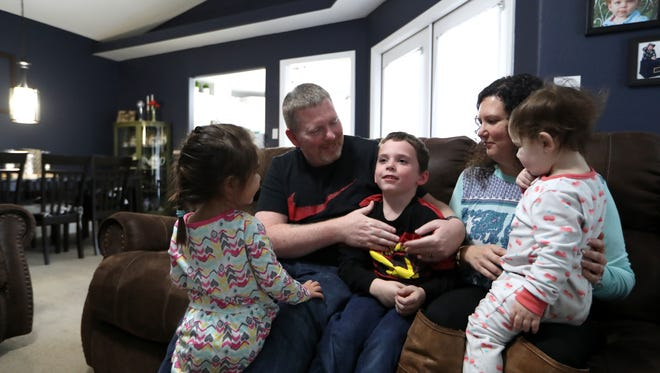 Foster parents Alyssa and Kyle Higgins at their home with son Jacob, 6, 3-year-old and 1-year-old foster children on Friday, Jan. 26, 2018. The Higgins have opened their home to seven different foster children over the last five years. Big Bend community based care preferred that the faces and names of the foster children were kept private.