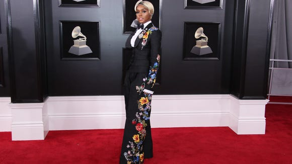 Janelle Monae didn't stop at one white rose...