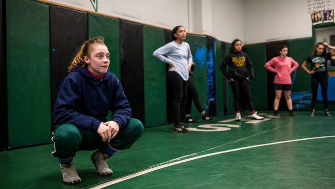 King's Mikayla Dockweiler watches her coach give instruction during their practice on Monday, Feb. 5, 2018 at King High School.